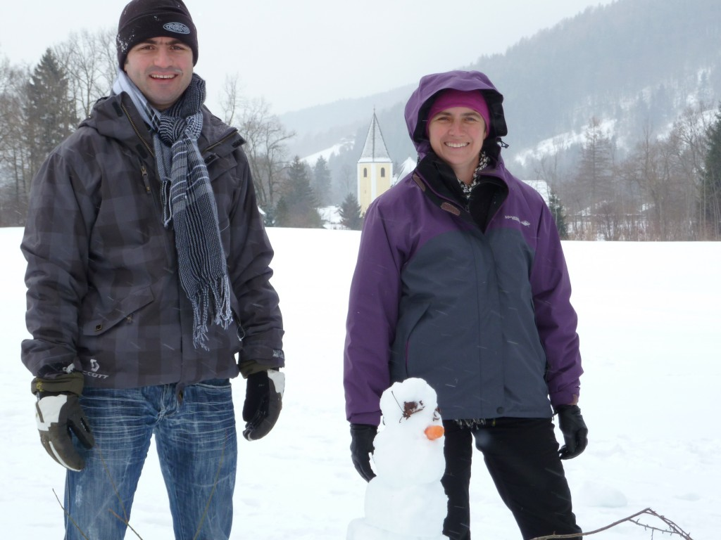 Bob takes a break to make a snowman with Jennifer
