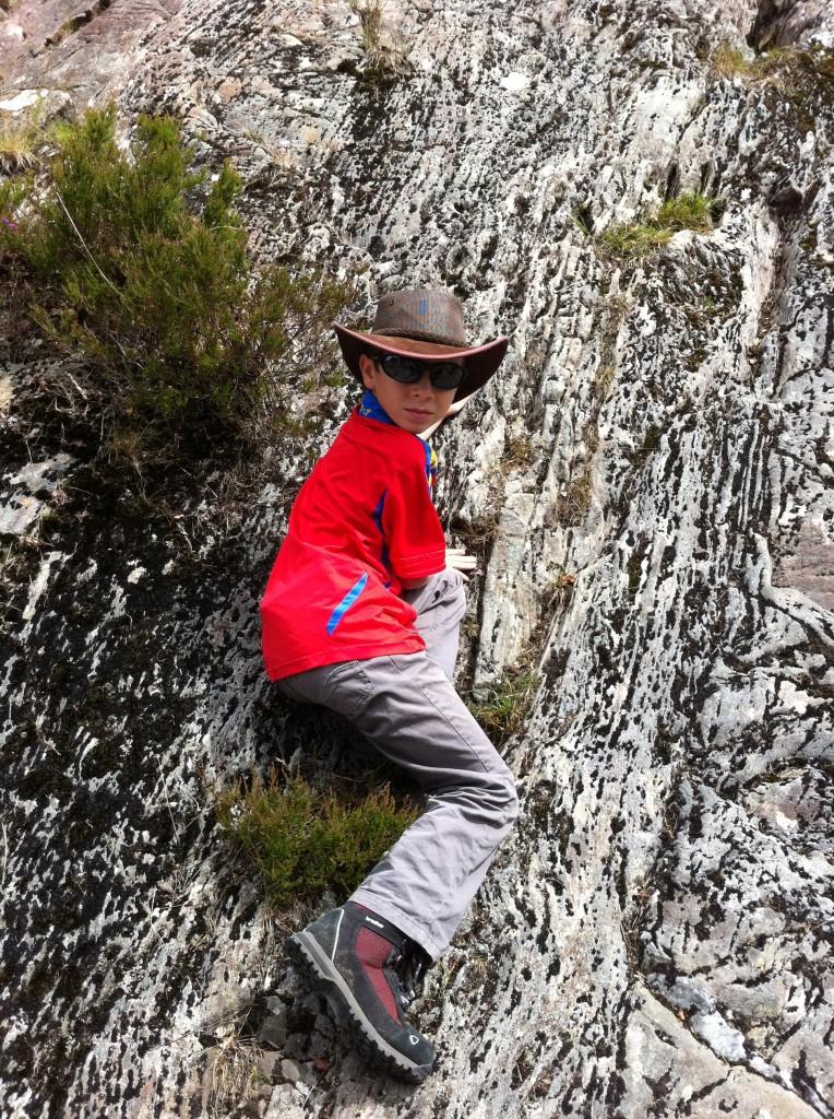 Declan climbs the glaciated walls at Loch Katrine