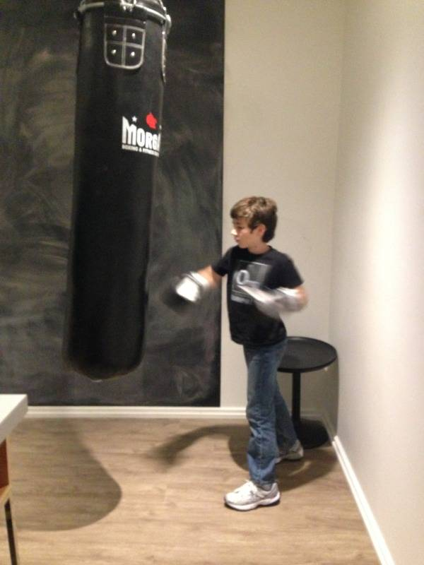 Declan working the bag in our hotel room.