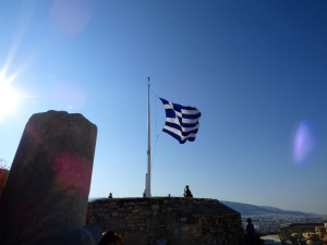 Raising the Greek flag.